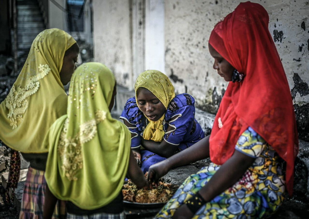 Goma, DRC, May 2020. A family gather for a meal to mark Eid in Goma at the end of Ramadan last week. © Ley Uwera for Fondation Carmignac