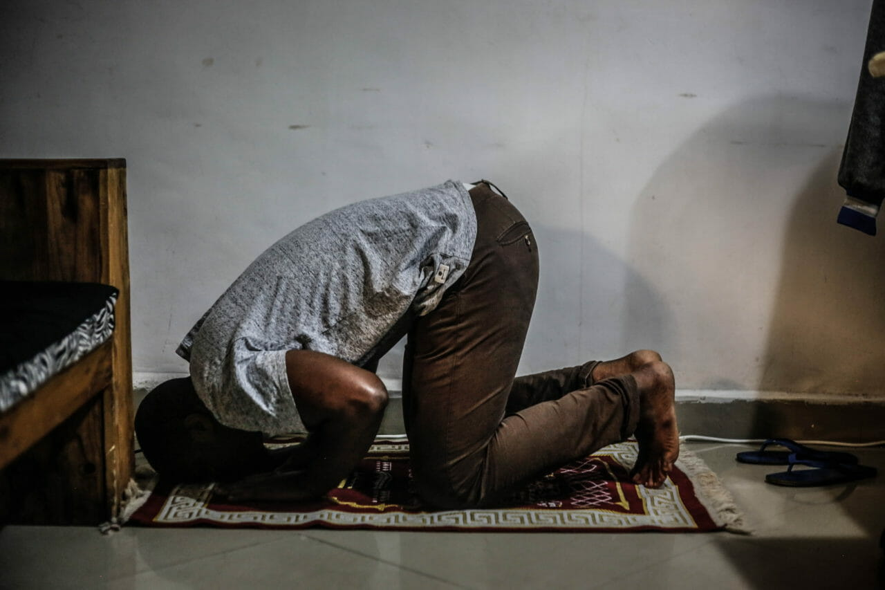 Goma, DRC, 2020. Unable to attend mosque to pray with others due to coronavirus restrictions, digital entrepreneur Ally Kahashi prays alone at home in his apartment in Goma. © Ley Uwera for Fondation Carmignac